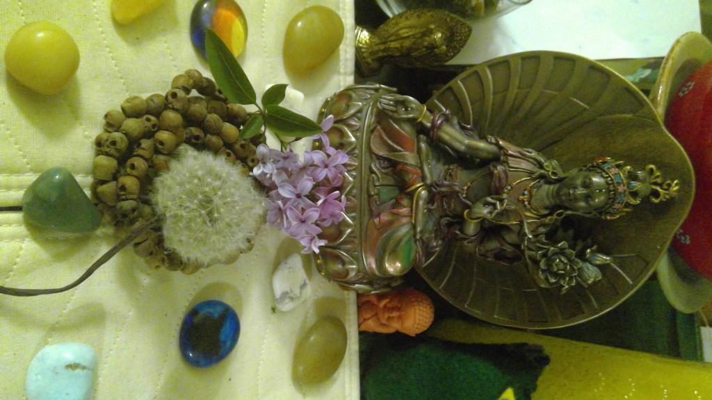 A staute of Tara on an altar.