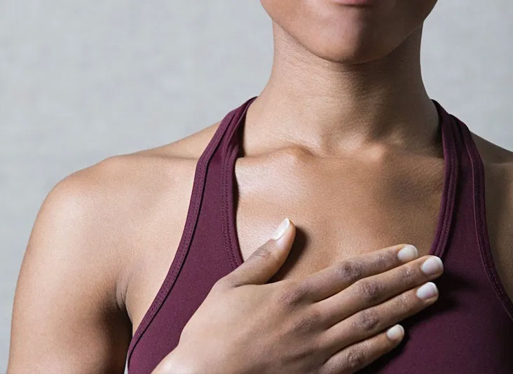 reiki-for-self-care-women-with-hand-over-chest